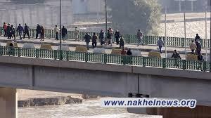 انقاذ فتاة حاولت الانتحار من أعلى أحد الابراج جنوب شرقي بغداد
