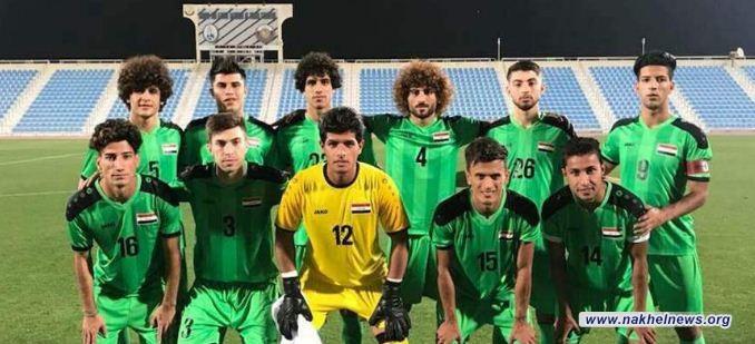 لاعبو الاولمبي سيرتدون الشارات السود حداداً خلال مواجهتهم اليمن