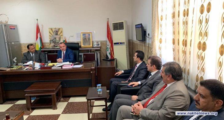 التجارة تبحث استغلال الطاقة الخزنية الفائضة بسايلو دهوك لخزن حنطة الموصل